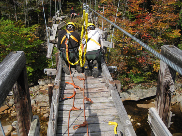 Another shot of White Mountain National Forest Trail Crew disassembles a 180' suspension bridge in the Pemigewasset Wilderness, NH.